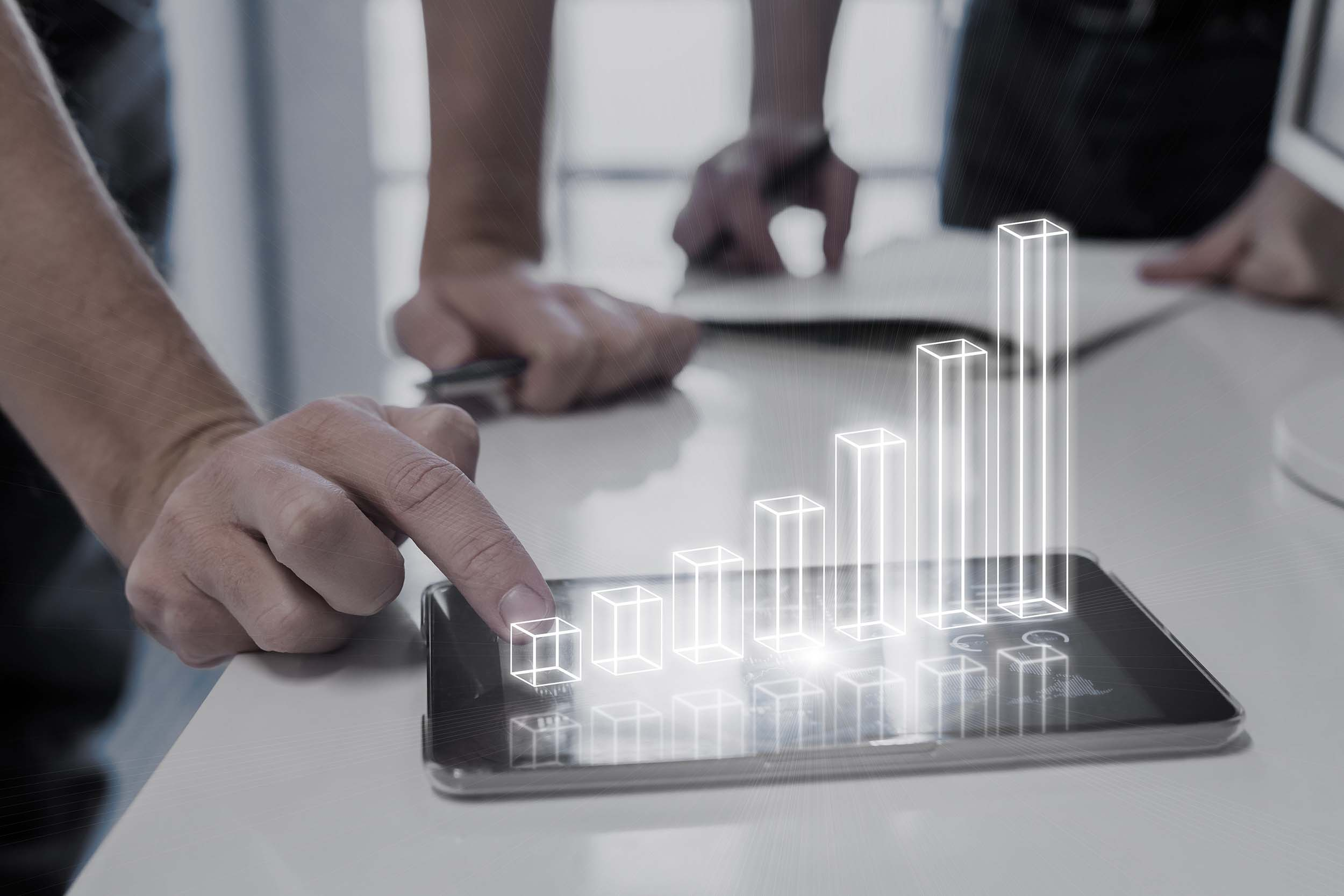 Augmented Reality Solutions by Cadesign form - a graph made of a digital projection sits on a table top